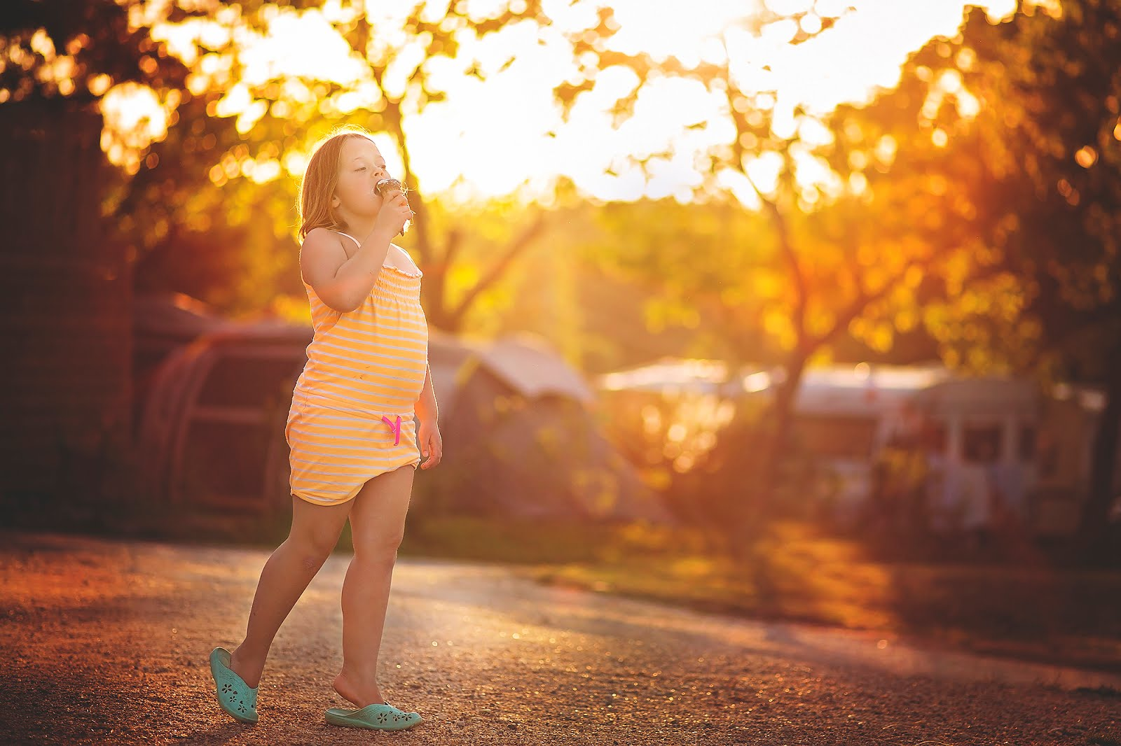 image of a girl eating ice cream in the Golden Hour by Willie Kers Photography