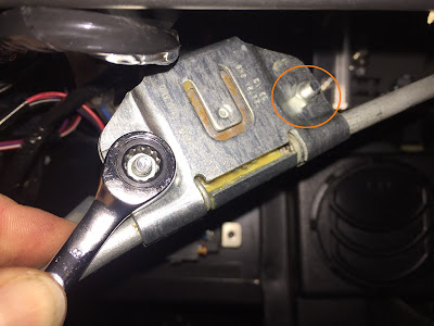 Use an 8mm spanner to loosen these nuts to remove the spindles from the wiper tube