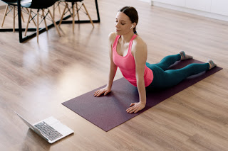 caucasian-woman-practicing-yoga-home_158595-5416