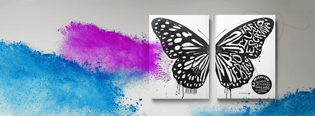 Um livro aberto com uma capa branca com asas de borboleta pretas, uma na capa e outra na contracapa