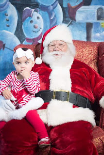Tater Tot's picture with Santa on her second Christmas