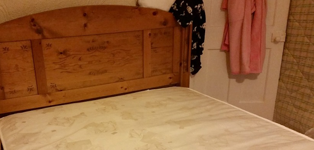 My pine bed frame with a new mattress on.