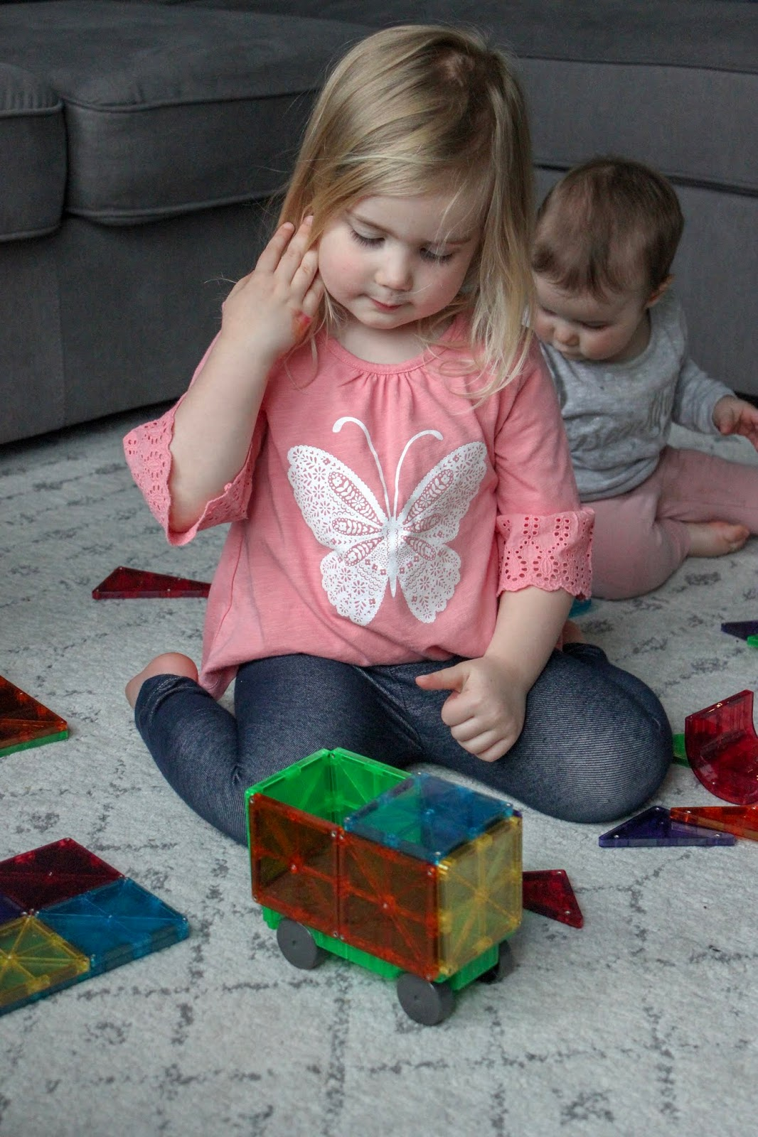 preschooler playing with magnetic tiles