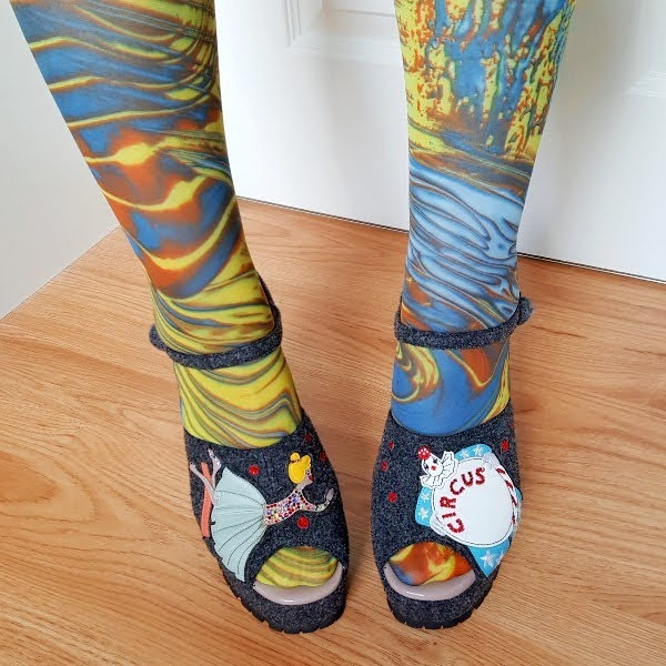 applique circus characters on grey felt platform shoes worn with marbled tights