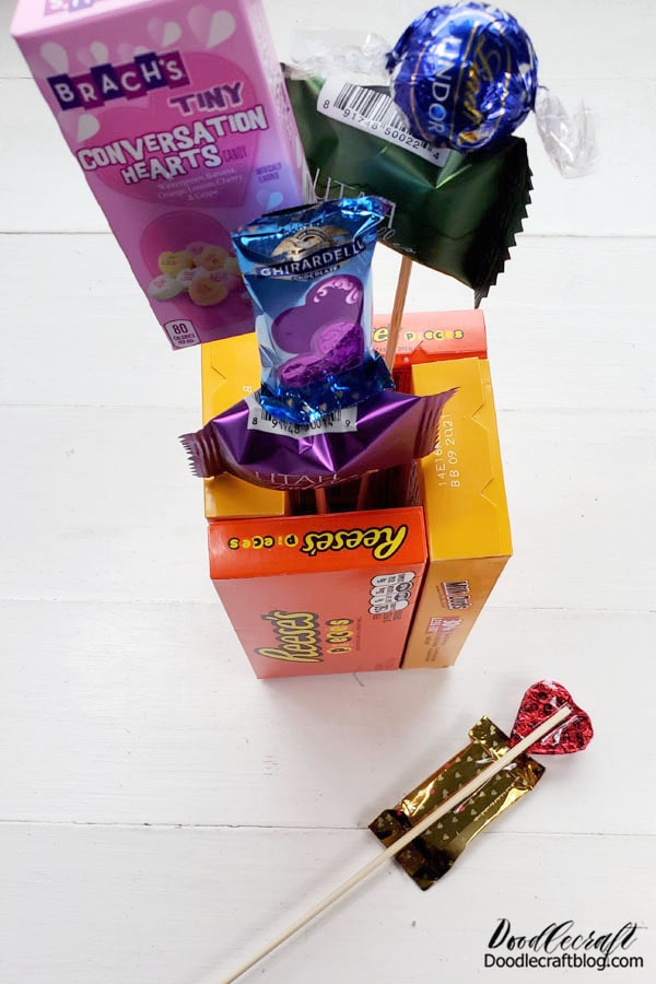 Use clear tape to attach the candy to the skewers...rather than piercing the candy with the wooden stakes like feral vampires.