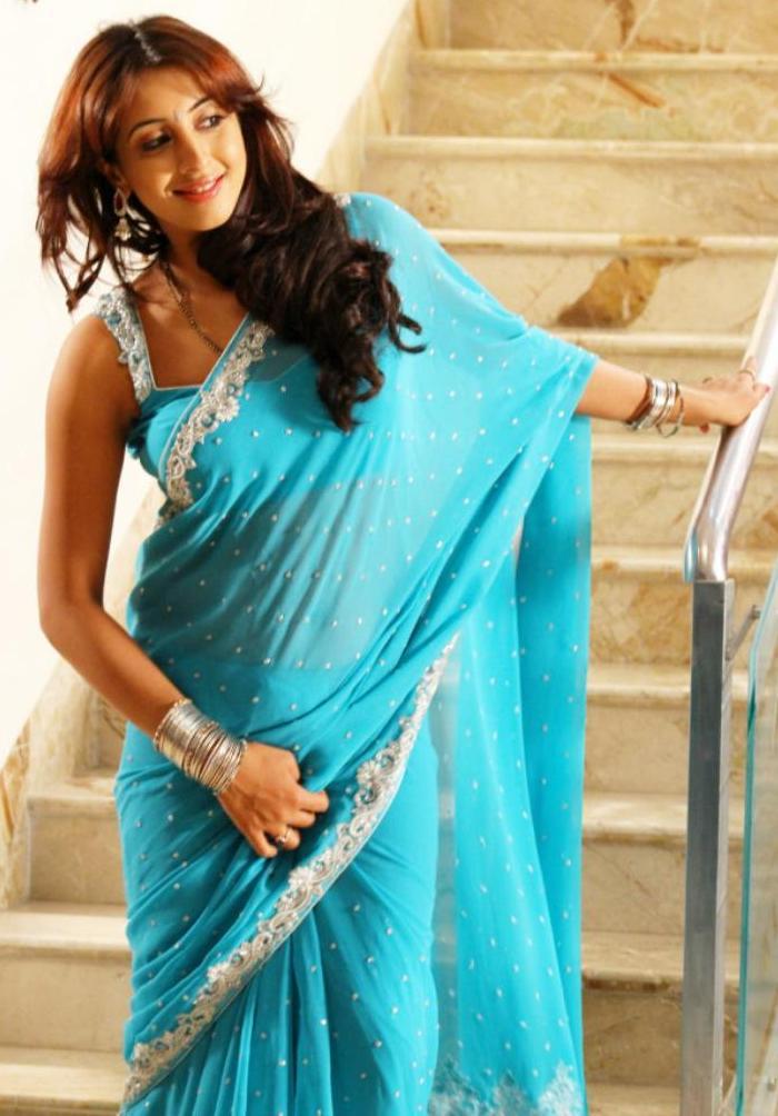Sanjana Hip Navel Stills In Transparent Blue Saree