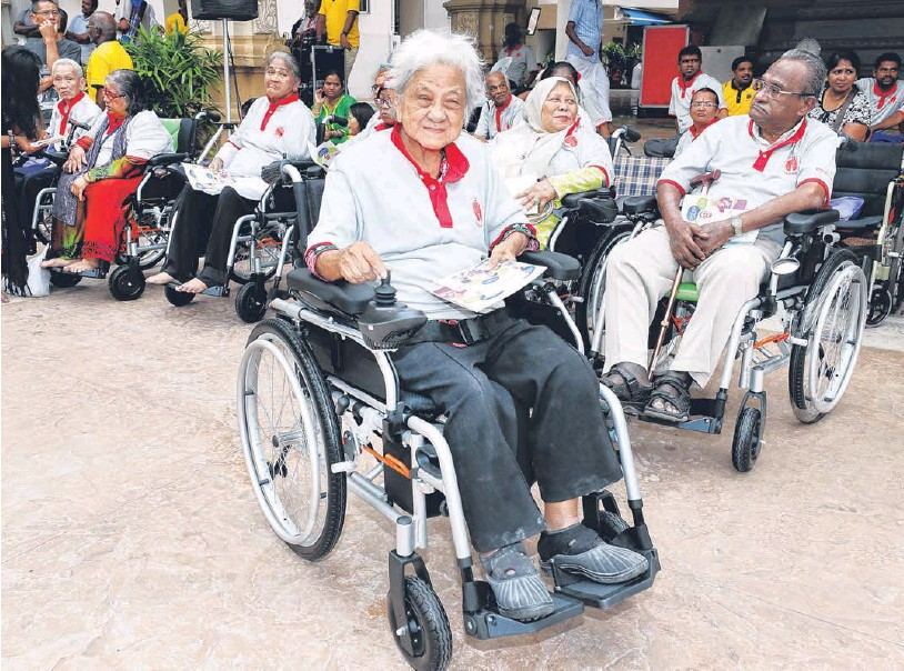 At Sri Thendayuthapani Temple in Tank Road, seven seniors each got a gift of a motorised wheelchair, and the society (the Chettiars' Temple Society) also donated a $130,000 mobile clinic to the Sunlove Abode for Intellectually-Infirmed.