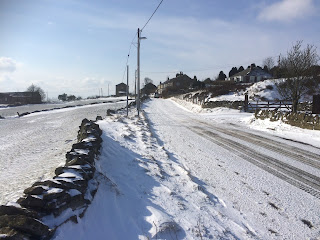 Country lane full of snow