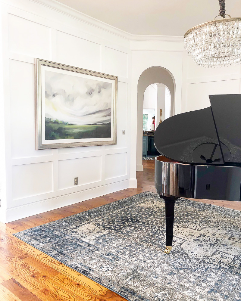 dining room turned music room with white wall trim