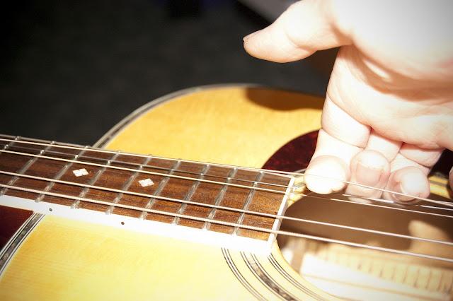 guitart restring an acoustic guitar. Black Bedroom Furniture Sets. Home Design Ideas