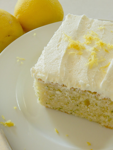 Lemon Zucchini Cake with Lemon Buttercream Frosting...all the flavors of summer in one cake!  Juicy lemons, shredded zucchini and a delicious buttercream frosting! (sweetandsavoryfood.com)