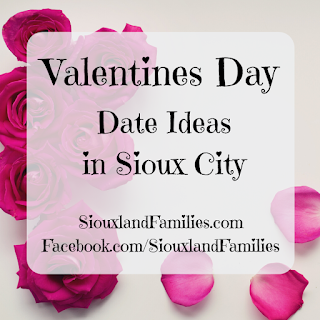 "dark pink roses and rose petals form a rough L shape on a light gray background. In the foreground, the words ""Valentines Day Date Ideas in Sioux City"" and ""SiouxlandFamilies.com"""