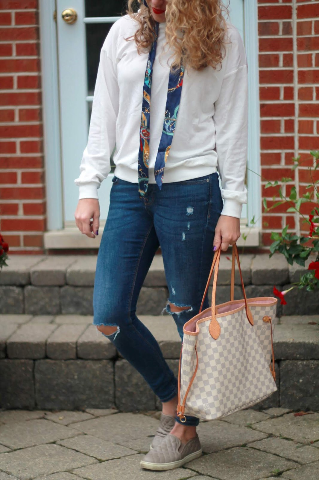 distressed jeans, white hooded sweatshirt, LV azure neverfull, taupe quilted slip ons