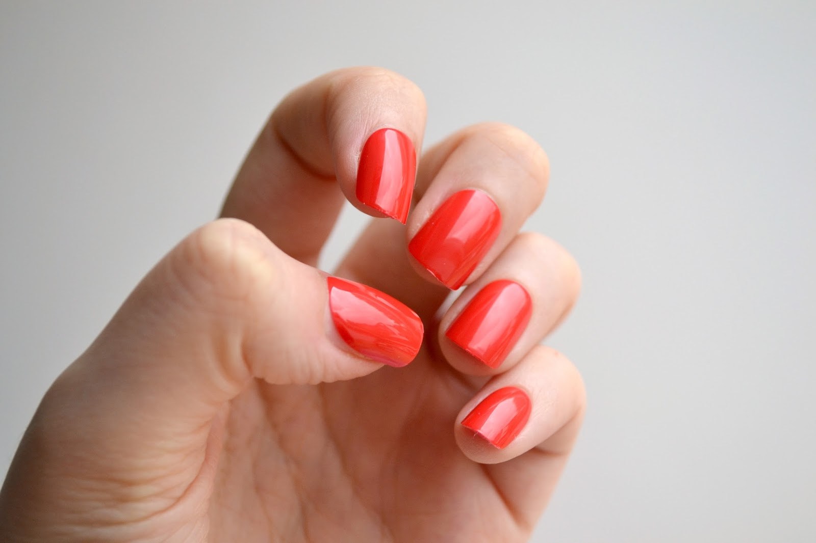 Elegant Touch Polished False Nails in Red on the nails