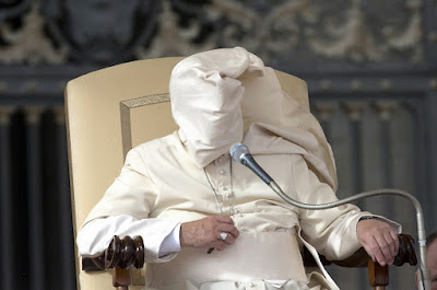 Pope with face covered