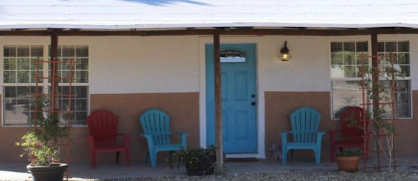 plastic Adirondack chairs on a porch in New Mexico