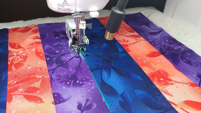 Using a sewing machine laser to stitch in the ditch