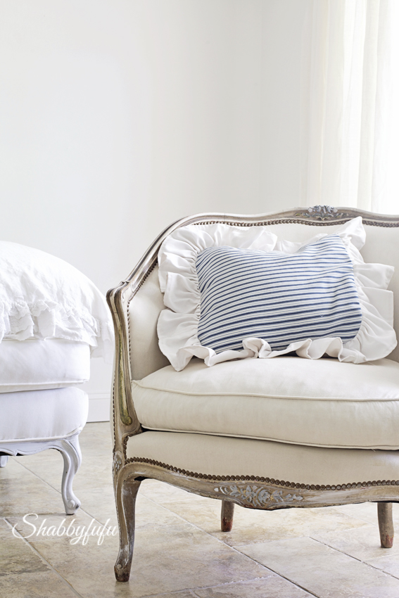 french chair with ticking stripe pillow
