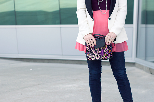 Color-blocked outfit with paisley purse.