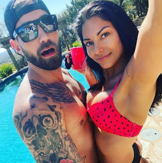 Mat Best clicking selfie with his wife Noelle Best