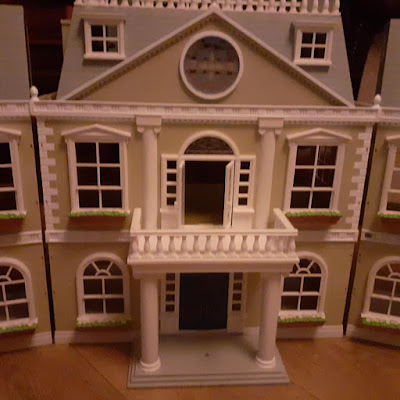 converting a dolls house to fairy house garden