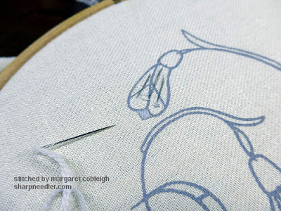 Close-up of Galanthus Collector stamped linen: uppermost snowdrop flower bud prior to being stitched