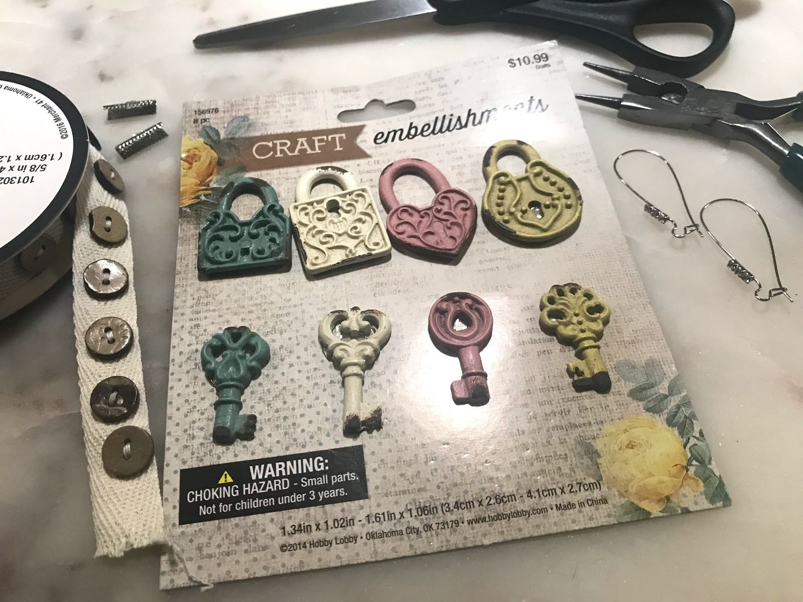 Image: All the items being used to make ugly earrings. Craft embellishments-scissors-ribbon trim-ribbon crimps-pliers. Seen first on bits and babbles blog