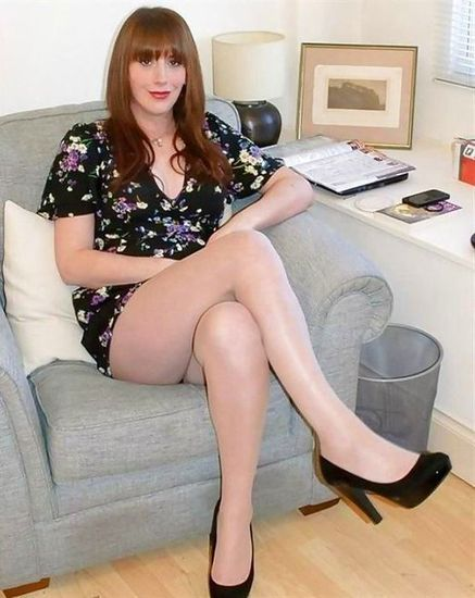 transvestite in the office with minidress