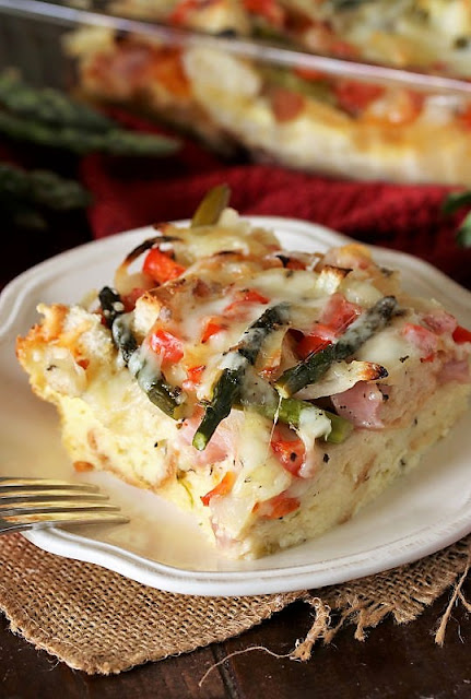 Piece of Overnight Asparagus Breakfast Casserole with Ham on Plate Image