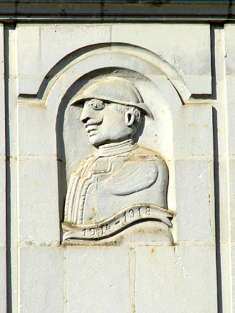 Folk art relief sculpture of a WWI soldier on a house, Indre et Loire, France. Photo by Loire Valley Time Travel.