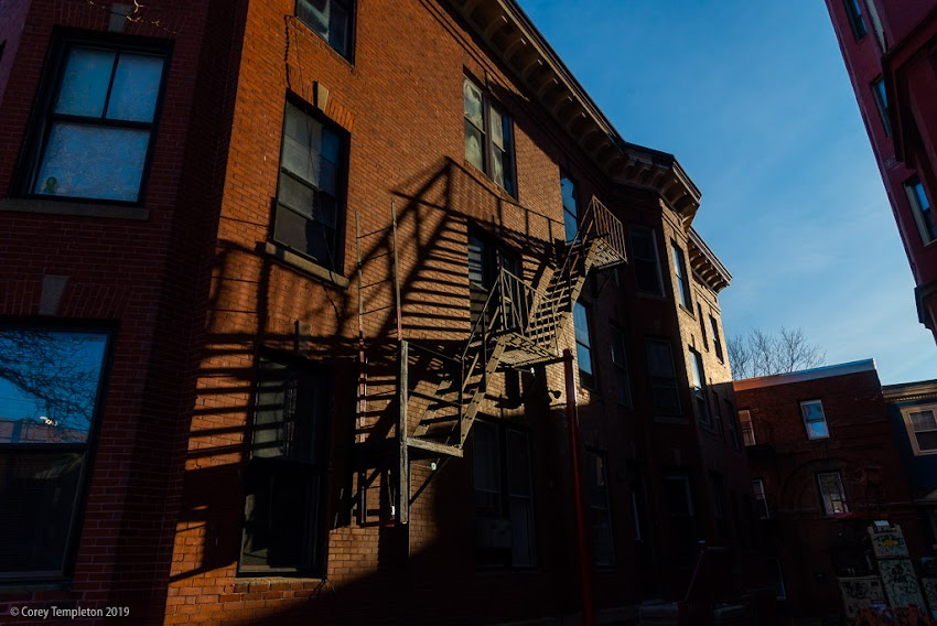 Portland, Maine USA December 2019 photo by Corey Templeton. Some well-defined fire escape shadows on Danforth Street.