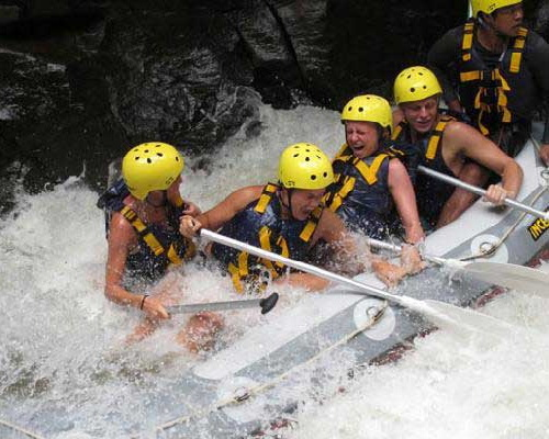 Tinuku.com Travel Ayung river rafting is most challenging in Ubud and watch beautiful carvings cliff along river