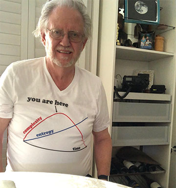 Resident Astronomer with Complexity-Entropy Curve on T-shirt (Source: Palmia Observatory)