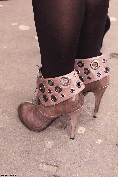 Different shoes,boots and high heels in the street of Milan. Street style fashion outfit.
