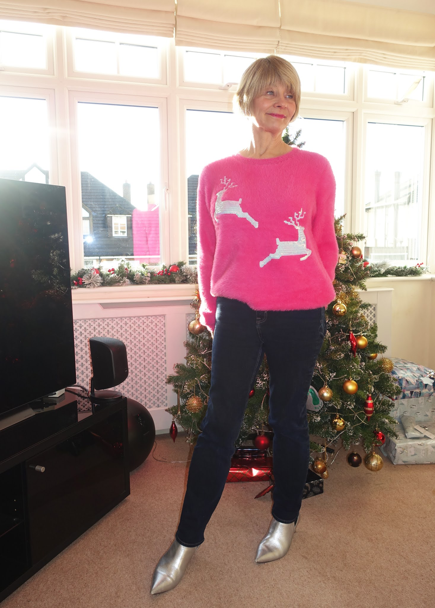Is This Mutton blogger Gail Hanlon in pink jumper with silver reindeer for Christmas 2020