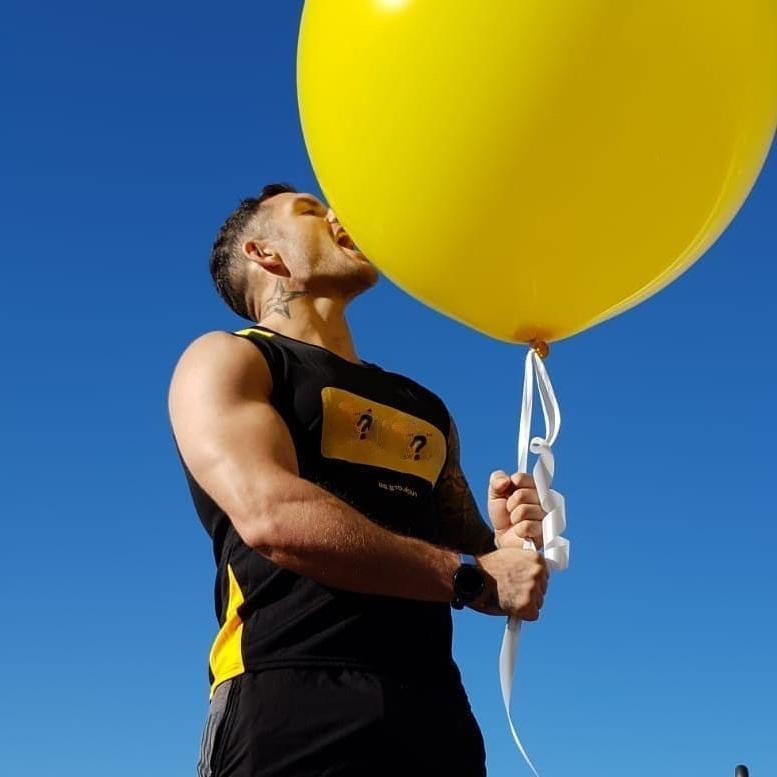 sexy-anonymous-masculine-guy-kissing-licking-huge-biggest-yellow-balloon-in-the-world