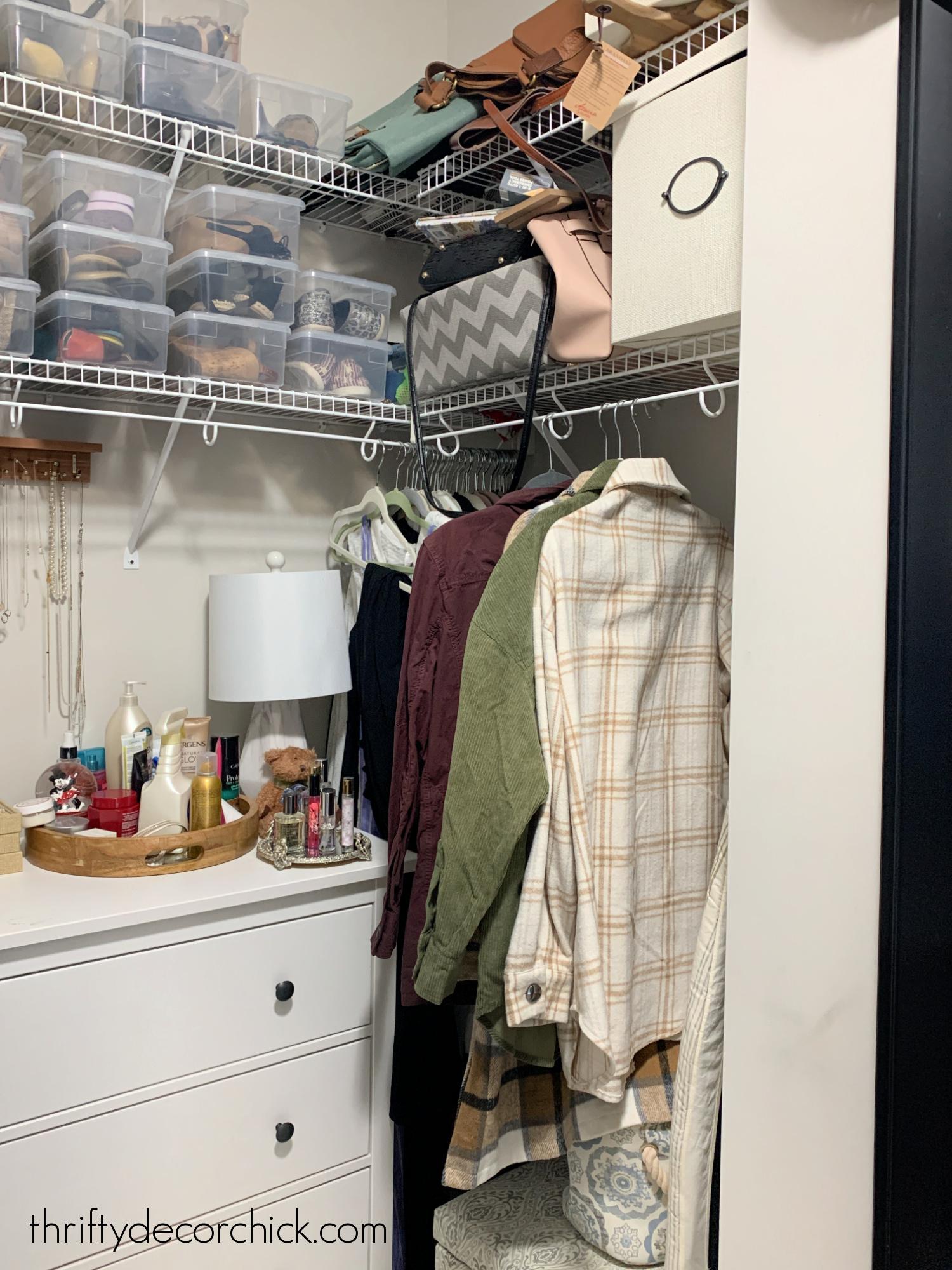 messy closet shoe bins before
