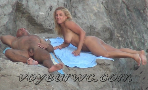 Beach 2304-2311 (Naked women caught on beach spy cam relaxing and enjoying nudity)
