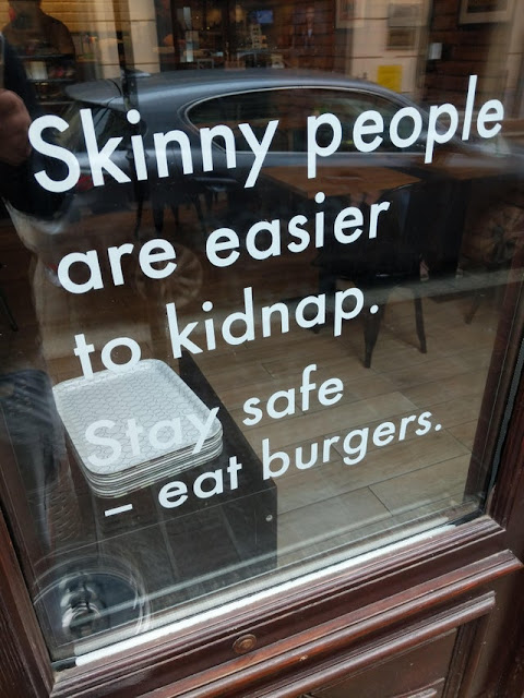 Sign on a window of a burger joint in Krakow, Poland