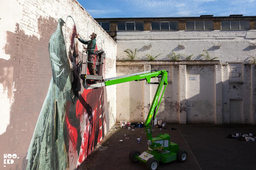 Irish artist Conor Harrington's at work on his Walthamstow Street Art Mural