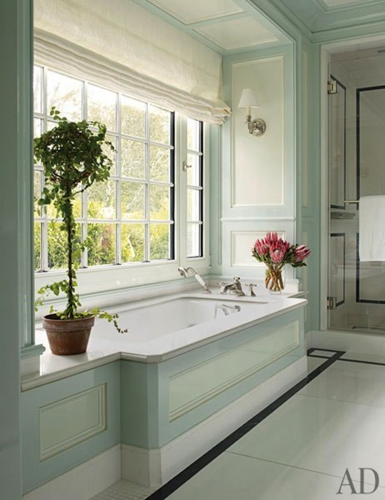 large master bath soaking tub in picture window, fretwork detail tile floor