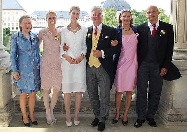 Princess Stephanie of Saxe-Coburg and Gotha wore a white silk wedding dress from German fashion designer Gordon Sieverding, who is based in Michelau