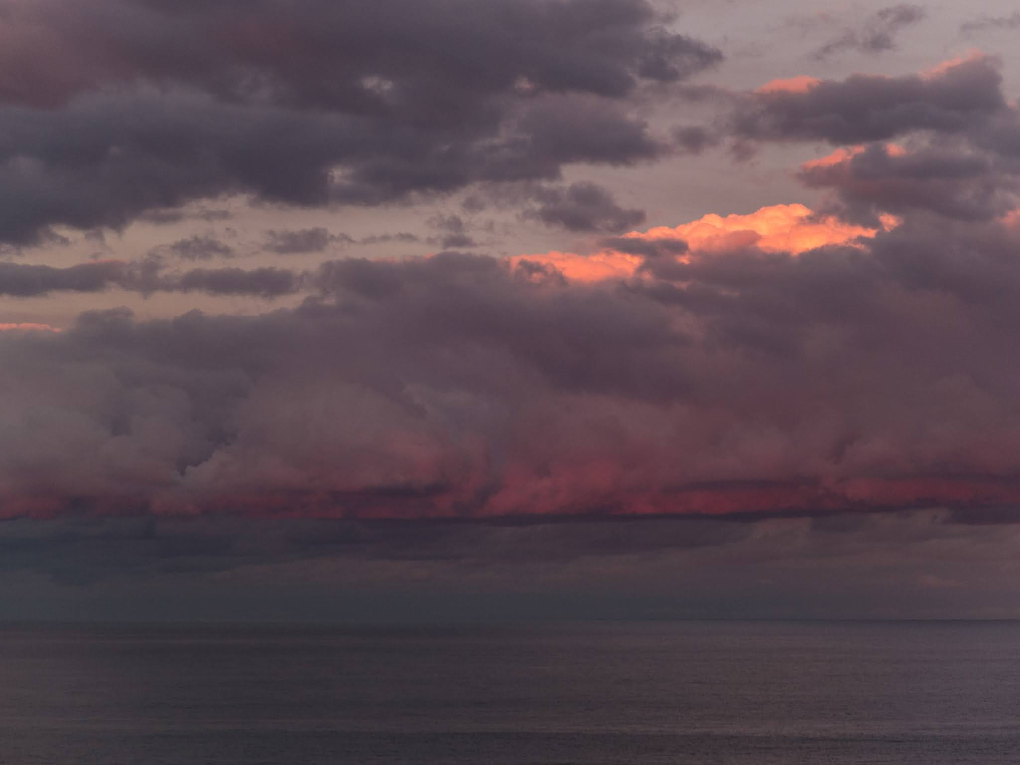 View of the Balearic Sea at sunset from the port of Barcelona.