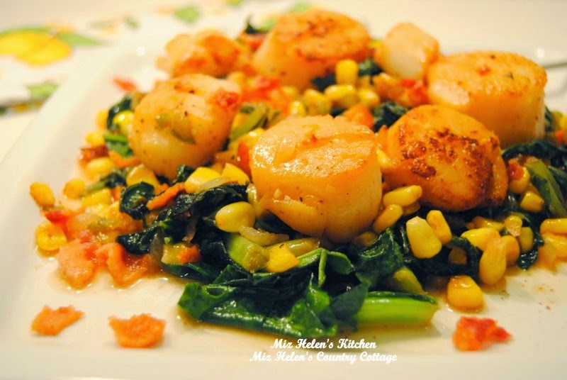 Seared Scallops with Garlic Pepper Sauce on Mustard Green and Corn at Miz Helen's Country Cottage