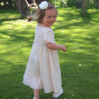 This dress would make a lovely flower girl outfit, it's classic and timeless