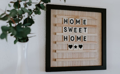 Home interiors sign saying home sweet home