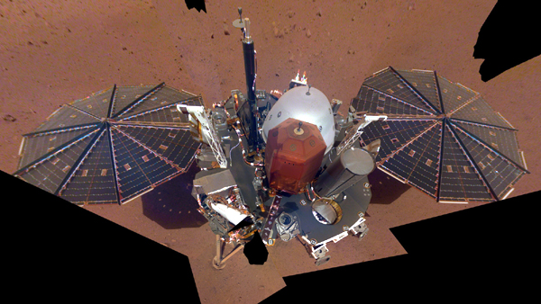 A composite image of the InSight lander that was taken with a camera on its robotic arm after the spacecraft touched down on Mars in late November of 2018.