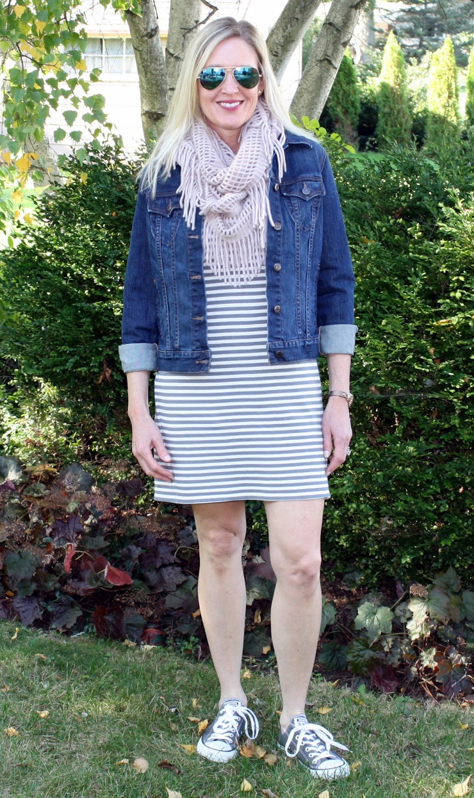 Everyone needs a striped dress in their wardrobe. Inspiration on how to wear a striped dress three ways!