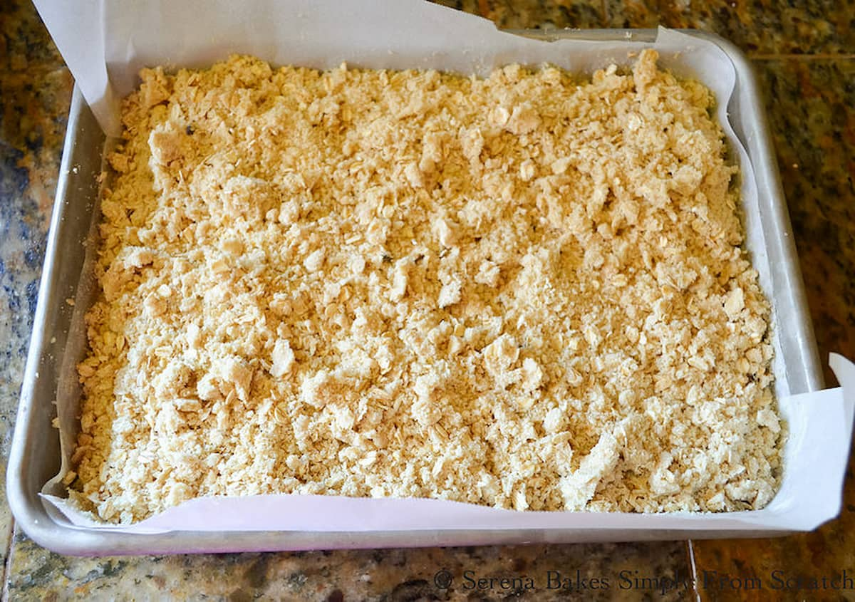 "Unbaked Lemon Cheesecake Crumb Bars topped with oatmeal crumb topping in a 9""13"""