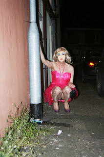Forced to walk the streets in a sissy pink dress